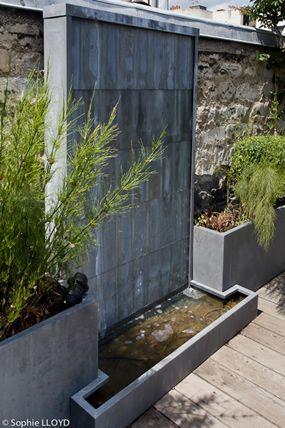 aménagement d'un mur d'eau sur une terrasse en ville