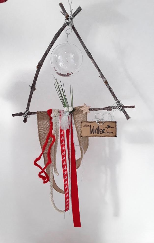 Hängedekoration dreieckig. Handarbeit vom Ballonladen. Dieses Dekogeschenk ist ein Unikat. Das tolle: Sie können hierin ein Geldgeschenk verpacken lassen.