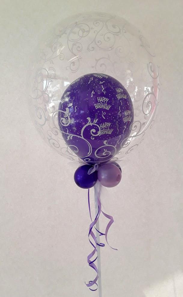 Geburtstagsbubble in verschiedenen Lila Nuancen. Außergewöhnliche Dekoration, die immer gut ankommt.