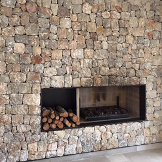 European photo of stone walls surrounding fire place, perfect for Sunshine Coast