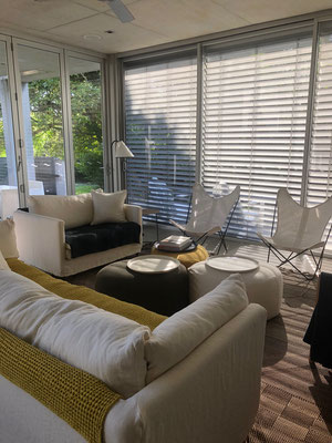 Caravane sofas and chair with ottomans, caravan lighting and French butterfly chairs in Peregian