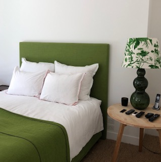 Green throw with bed lamp