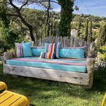Outdoor canvas cushions brings life to an old piece of furniture