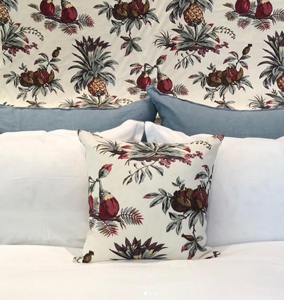 Penny Morrison, Dominica pillow with matching bed head with white and light blue Caravane linen pillows in 50 x 50cm