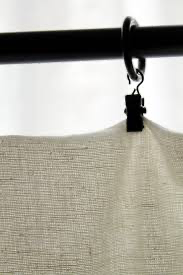 Hard Plastic Clip that clasps the Linen Curtain and moves along the black iron rod attached to the wall