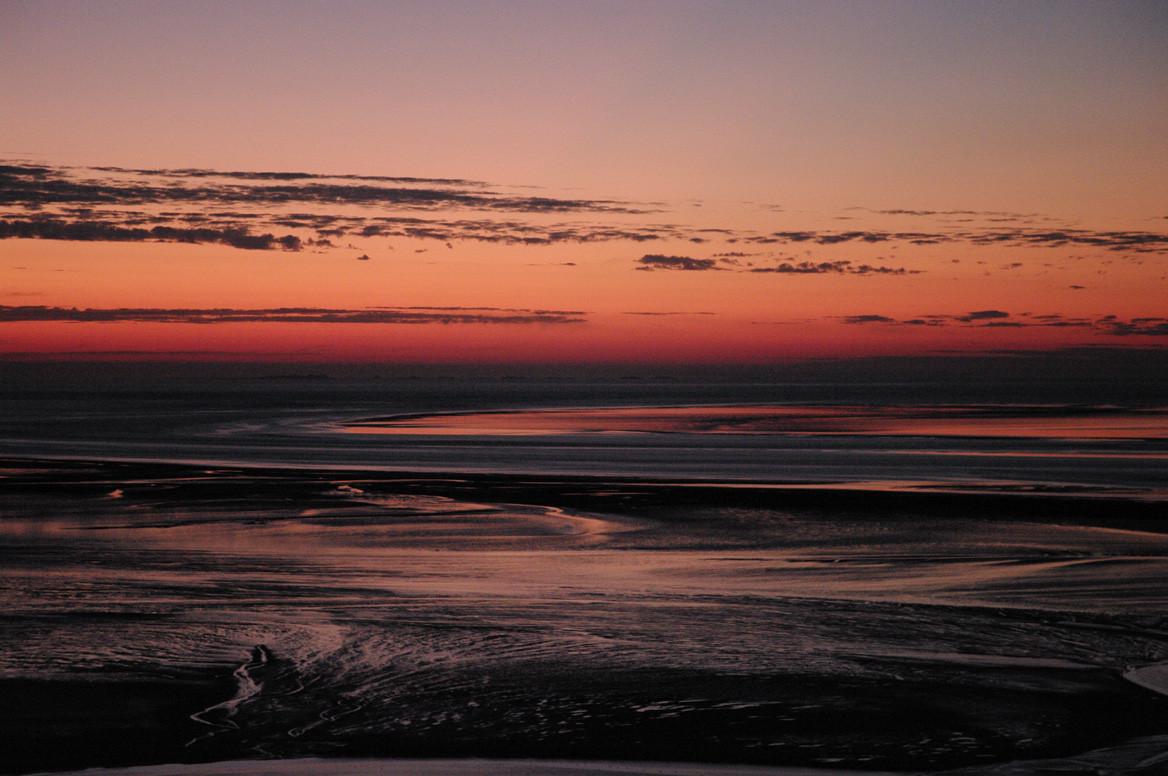 De la terrasse, coucher de soleil sur la baie à marée basse