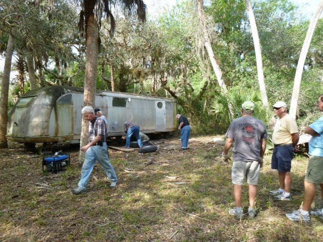 Russ Johnson and other Sarasota County volunteers clear the area of debris.