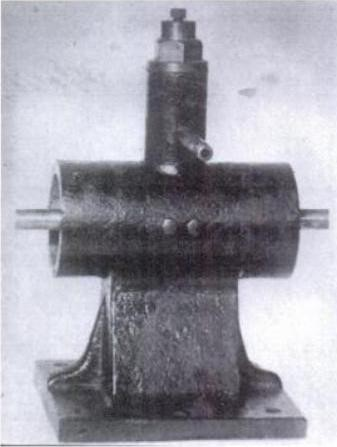 Simple mechanical oscilator used in first experiments - Original reciprocating steam engine, latter fitted with coils and magnetic fields to produce currents of precisely constant frequency