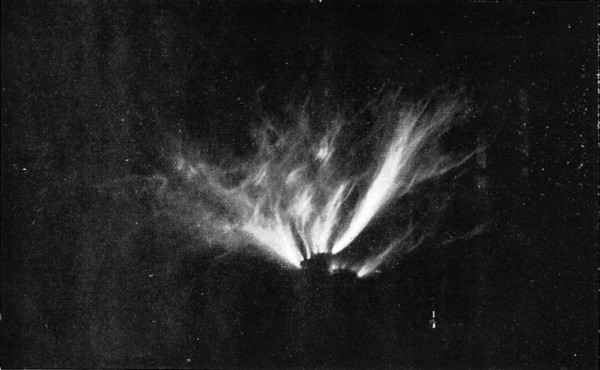 Fig. 14. — Effect of electrical discharge from the earth by Tesla coil. (Photograph by its own light.)
