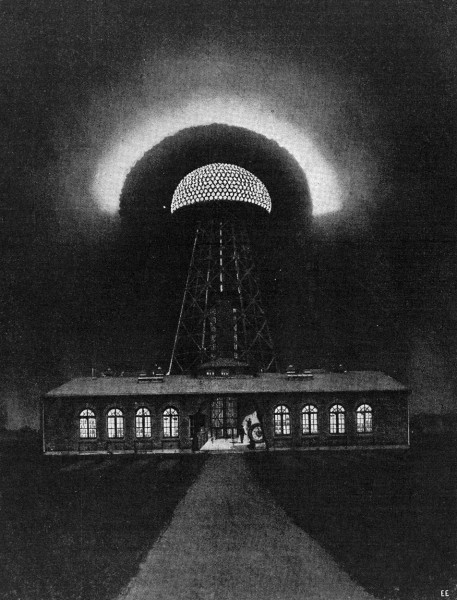 Fig. 1. — Probable Appearance of the Wonderful Tesla Oscillator Tower at Night — It Is Located at Shoreham, L. I., and Is Intended for Radiating Electrical Energy in the Form of High Frequency Waves Propagated Thru the Earth Itself — Tower Stands 185 Feet