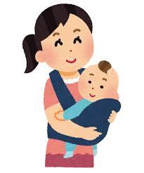 赤ちゃんを抱っこひもで抱っこしているお母さん