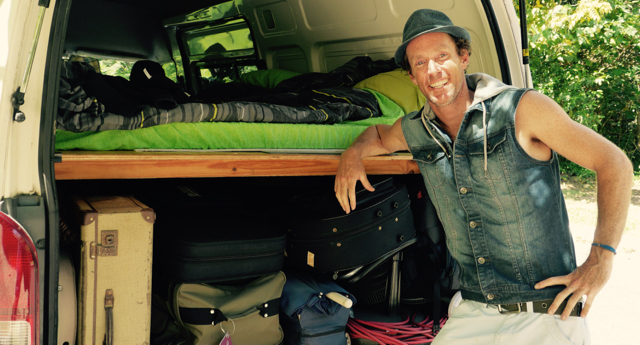 Juzzie Smith with his touring van. Gear on the bottom, Bed on the top. Nice
