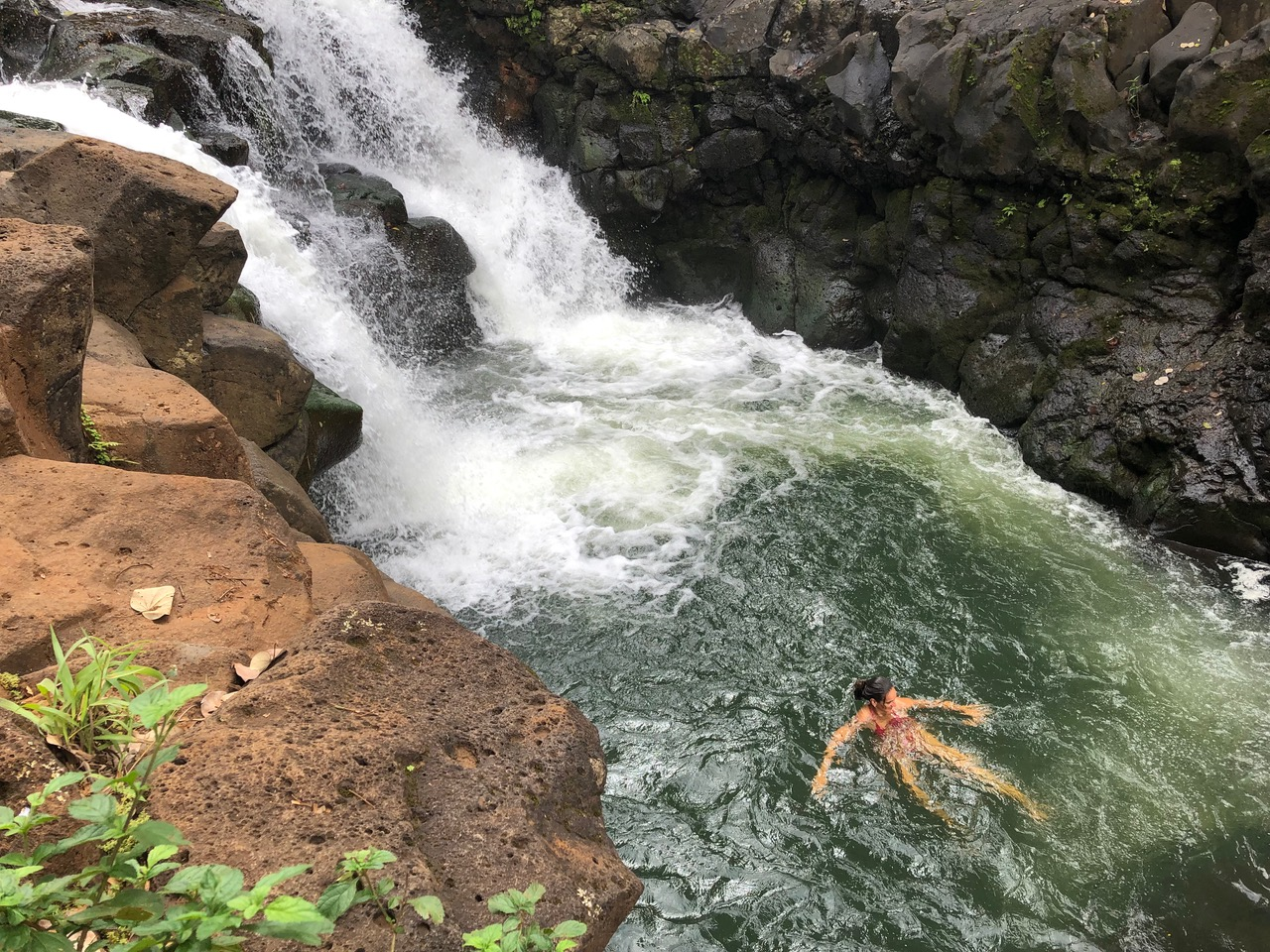 in the pool below the falls