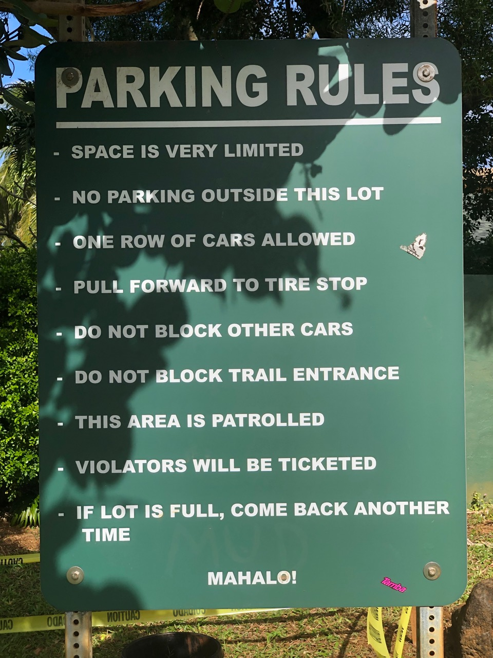 One of many parking rules in Kauai. This one was at Queens Bath a very popular but dangerous attraction...