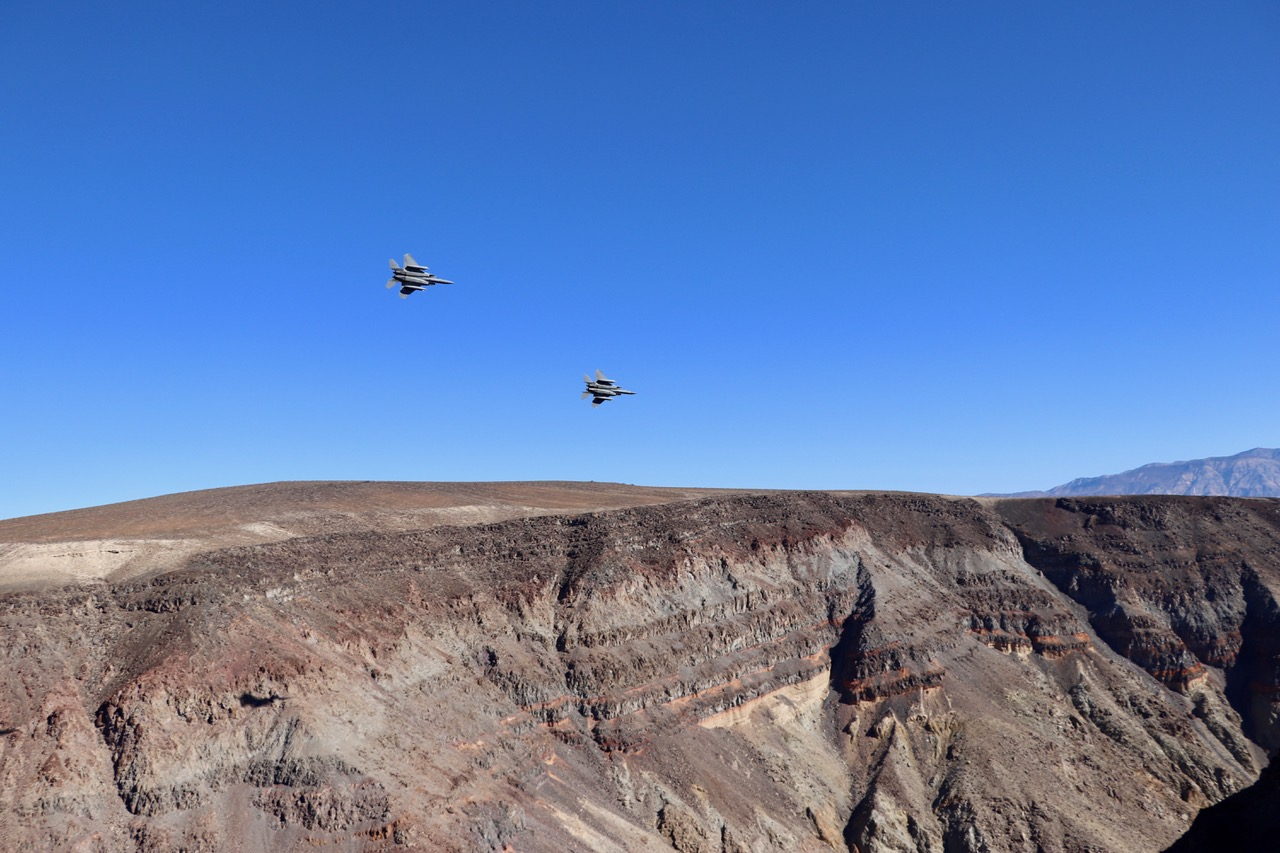 ...believe it or not but that moment came as we arrived and looked down Death Valley only to see two US Jet Fighters in low level flight coming right at us!!