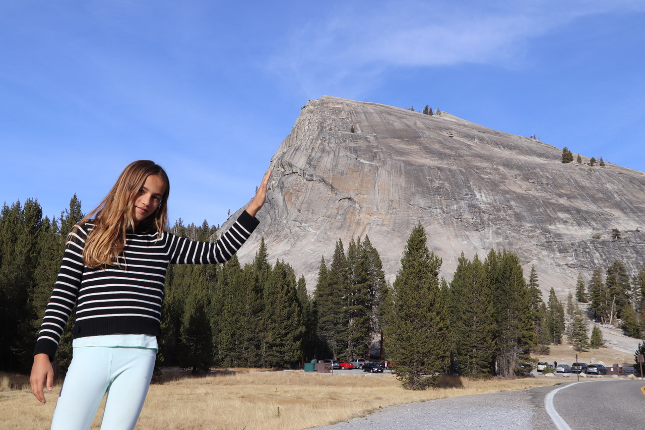 Lynn leaning on Lambert Dome in Yosemite National Park