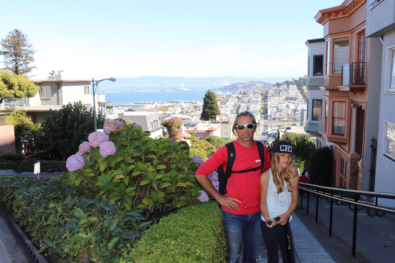 In front of the green curving Lombard Street