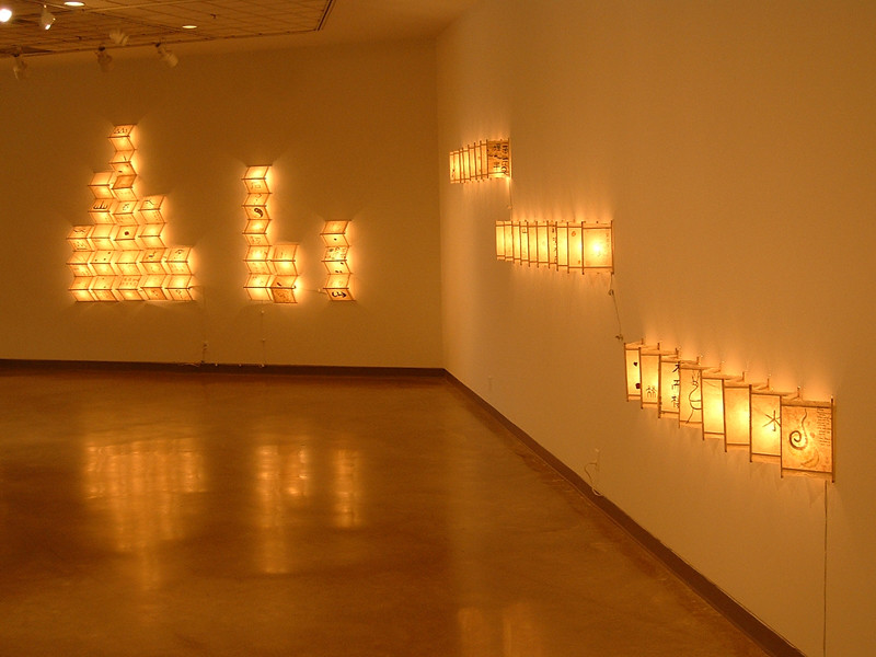 "Installation detail, Self Hand made paper, wood, ink and lights, 84""x204""x 6"", 2004 - 2006"