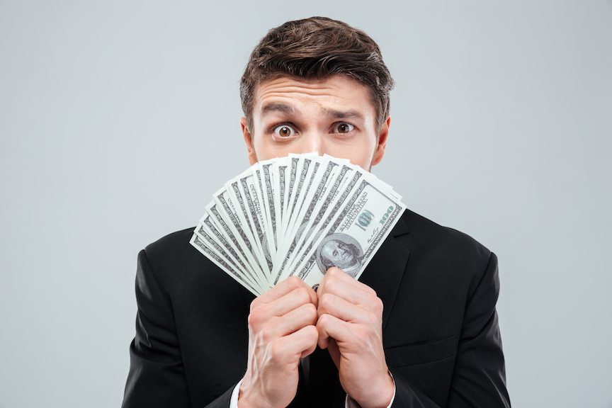 Man holding fanned out money confused about Registered Investment Advisors