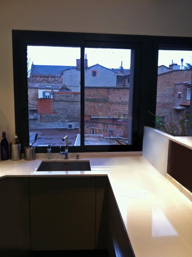 cuisine en laque et plan silestone par Cuisine interieur design Toulouse