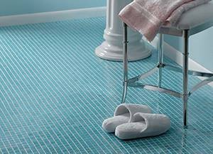 Small blue glass tiles on a floor.