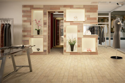 A light, airy color on the floor and a blend of colors on the wall add a natural-looking element to this shop.