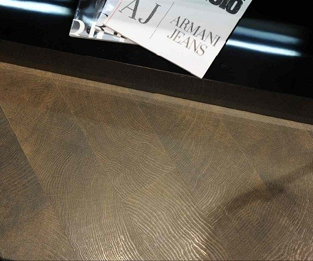 Wood porcelain with ridges that capture the light and add to the realism of this durable floor.