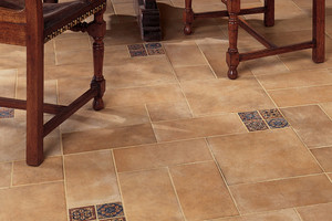 Tan floor with painted accent tiles.