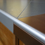 Close-up of porcelain countertop with Schluter metal edging