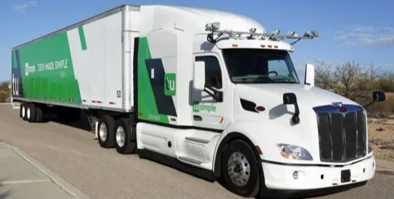 "In it for the ride: self-driving trucks have a human on board ""just in case"" - Image: TuSimple"