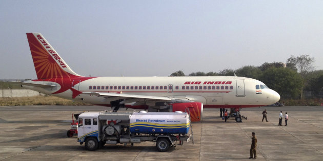 Pay the fuel bill or be grounded. Pictured here is an Air India A320 being refueled.