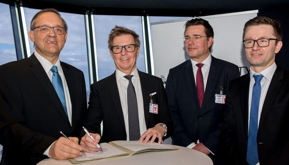 Signed the agreement (left to right): Guenther Ofner, Vienna Apt., DHL exects Hermann Filz, Horst Sorg, Christoph Wahl