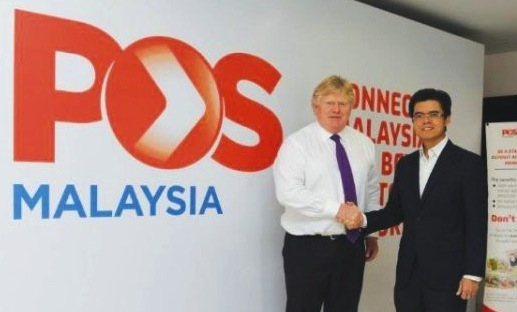 Tigers' CEO Andrew Jillings (left) with Dato' Mohd Shukrie Mohd Salleh, Group Chief Executive Officer, Pos Malaysia