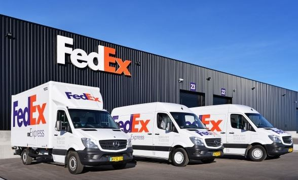 FedEx vehicles in front of the integrator's new Copenhagen facility  -  company courtesy