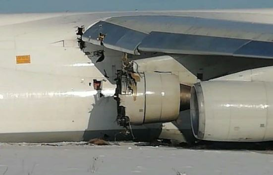 Parts of the engine have punctured the aircraft hull