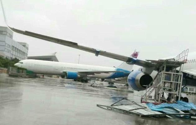 Damaged Chinese aircraft blown off its apron stand by the force of a typhoon  -  courtesy: Weibo