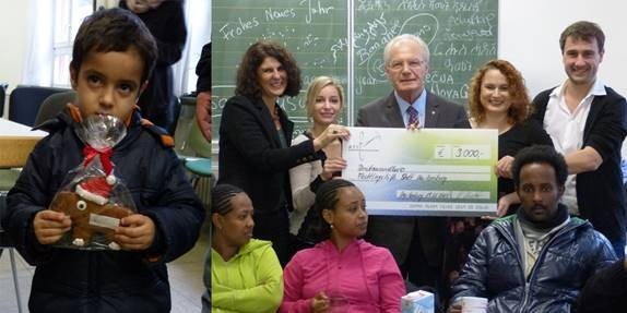 Yvonne Nuechter of ATS (standing right) hands over the cheque to Neu-Iseburg's mayor Hubert Hunkel and Paola Fabbri Lipsch /  Source
