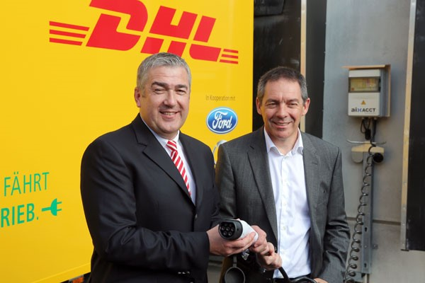 From L > R: Juergen Gerdes, Member of the Board of Management Post - eCommerce - Parcel, at DP-DHL Group and Steven Armstrong, group vice president and president, Europe, Middle East & Africa, Ford Motor Company presenting the battery charger  -  courtesy