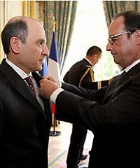 QR's Akbar Al Baker receives the Legion d'Honneur from French president François Hollande.