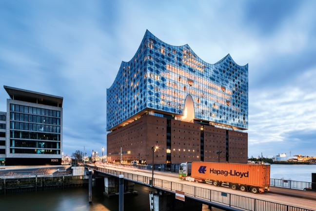 H-L box rolling by Hamburg's new landmark Elbe Philharmonic Hall – probably on way to Africa or India  -  company courtesy.