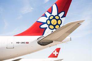 Edelweiss A340 at ZRH flanked by aircraft of parent Swiss