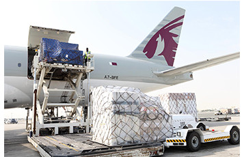Loading of Boeing 777F operated by QR Cargo  -  courtesy QR