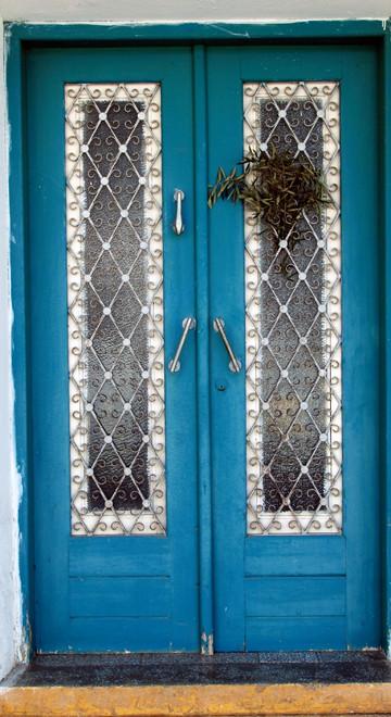 House door with olive branch to ward off the Kallikhantzari