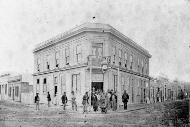 Tait Brothers (1864-1867) The Digger's Arms Hotel in Hokitika, Westland. Ref: PAColl-7489-46. Alexander Turnbull Library, Wellington, New Zealand.