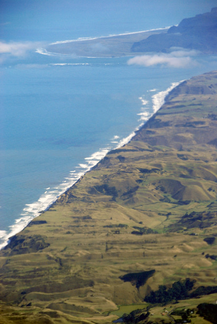 The Tasman Sea banging into New Zealand at the mouth to the Manukau Harbour, Whatipu in the distance.