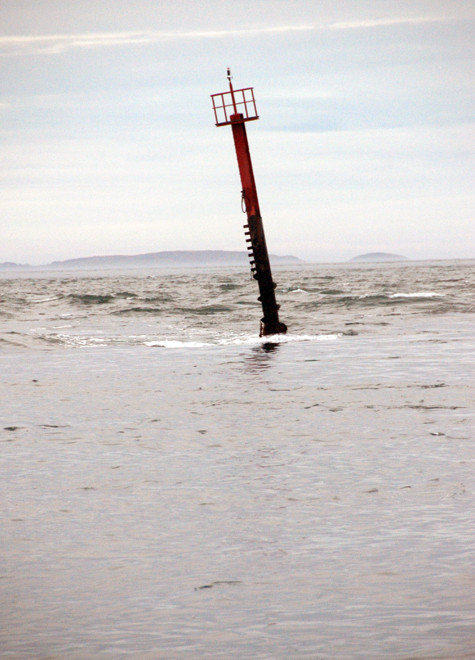 Tide race around one of the North Channel marker poles, Bluff.