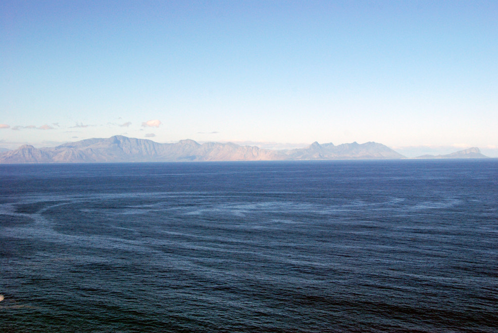Circular patterns on the water of False Bay with the Kegelberg Mountains from Betty's Bay to Gordon's Bay