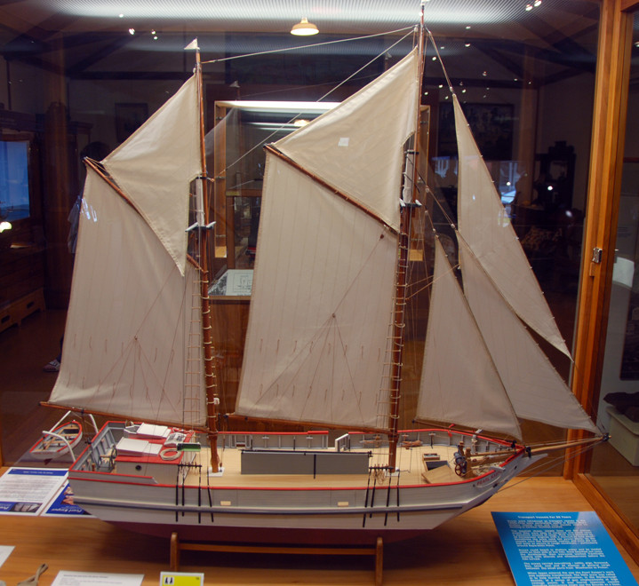Model of a scow, a shallow draught vessel ideal for the shallow seas of Golden Bay. They were used from the 1890s  for all sorts including shipping butter in to Wellington in kahikatea boxes - clink l