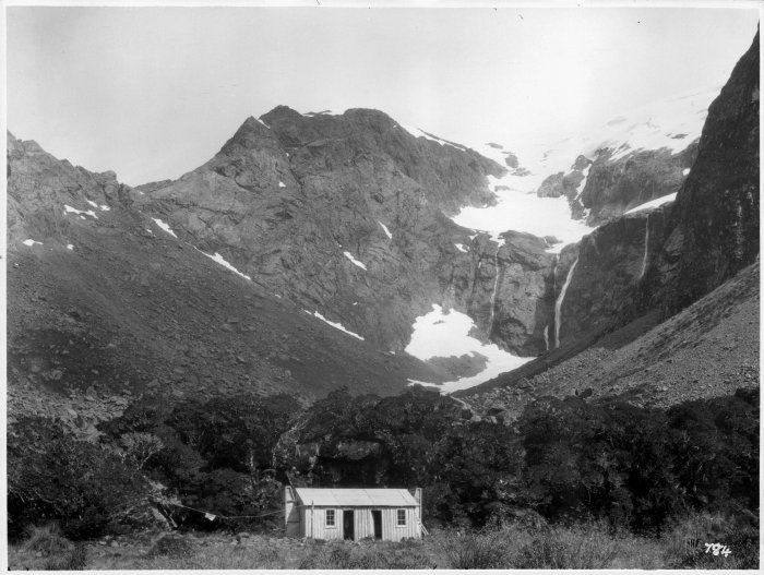 By complete chance the photo above and this one are almost the same but separated by nearly 100 years. View looking up the Homer Valley, showing the Homer Hut in the foreground, photographed in the 1920s by Algernon Gifford (Turnbull Collection - click)