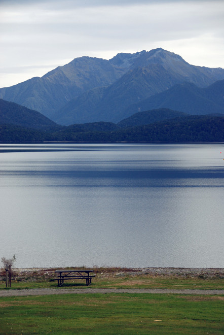 The dead flat waters and light of Lake Te Anau at midday in late summer.